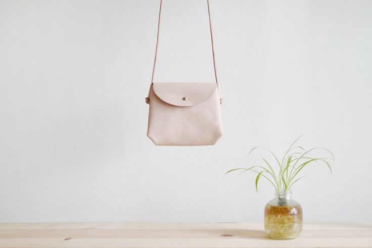 Mini Crossbody Sling - small leather bag in natural nude by smallqueue on Etsy https://www.etsy.com/listing/214338992/mini-crossbody-sling-small-leather-bag
