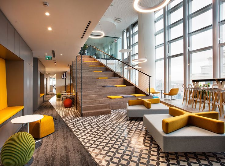 Tiered stadium seating and tiled floor from Allianz Offices – Istanbul