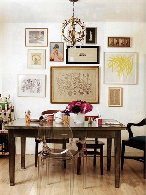 I Love This Sort Of Eclectic Vintage Dining Room The Wall Art Arranged Just Right With Different Frames Lucite Chairs Take Some Weight Away And Are