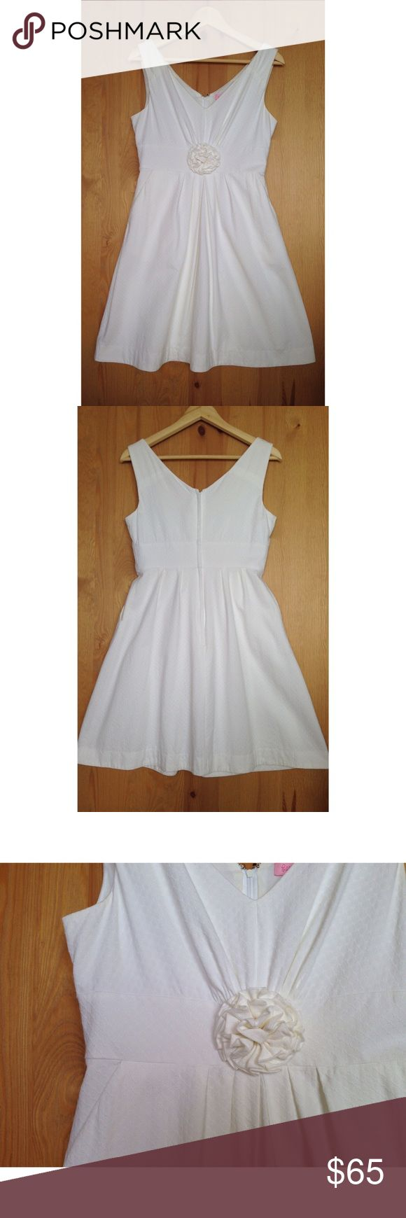 Lilly Pulitzer white dress Lilly Pulitzer white dress with flower detail. Size 6. Has pockets. Back zip. Shell & lining: 100% cotton. EUC, worn exactly twice Lilly Pulitzer Dresses