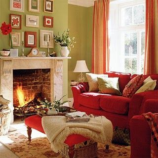 The Romantic Red Couch And Light Green Wall Create A Complementary Color Scheme