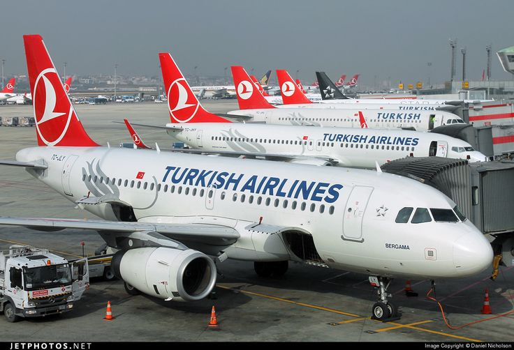"Turkish Airlines Airbus A319-132 TC-JLY cn 4774 December 14, 2014 Photo by: Daniel Nicholson ""A busy lunchtime line-up of Turkish Airlines at Ataturk airport."" [Note: The second aircraft, TC-JHY, is a Boeing 737-800.]"