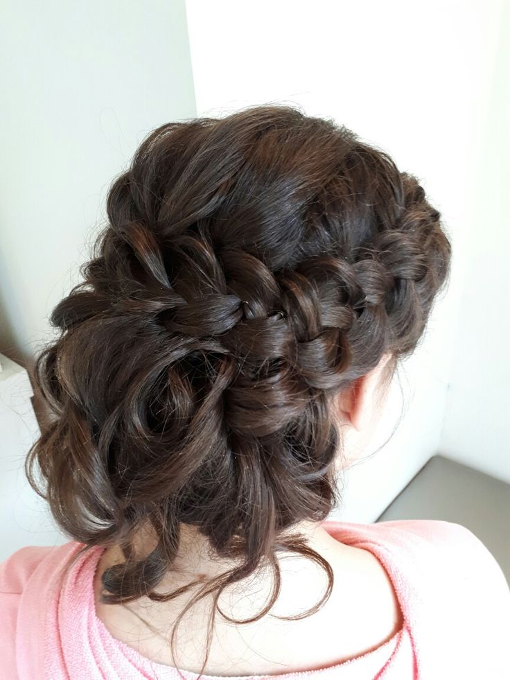 A formal romantic  braided  updo for a graduation, prom or a wedding