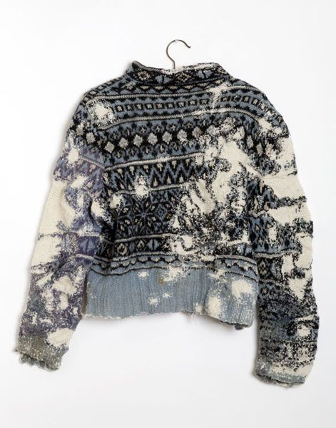 Sustainability. This is a piece called Norwegian Sweater by Celia Pym. She took an old, damaged jumper that couldn't be worn and repaired it to create this. It reminds me of the 'make do and mend' attitude people used to have - proof you can turn something that is no use to anyone into something beautiful and functional again.