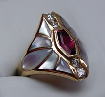 Vintage art deco. Diamonds, mother of pearl and a ruby.