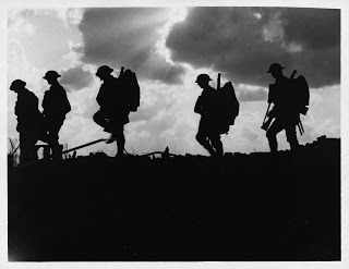 Taken by Ernest Brooks during the Battle of Broodseinde, showing a group of soldiers of the 8th East Yorkshire Regiment moving up to the front