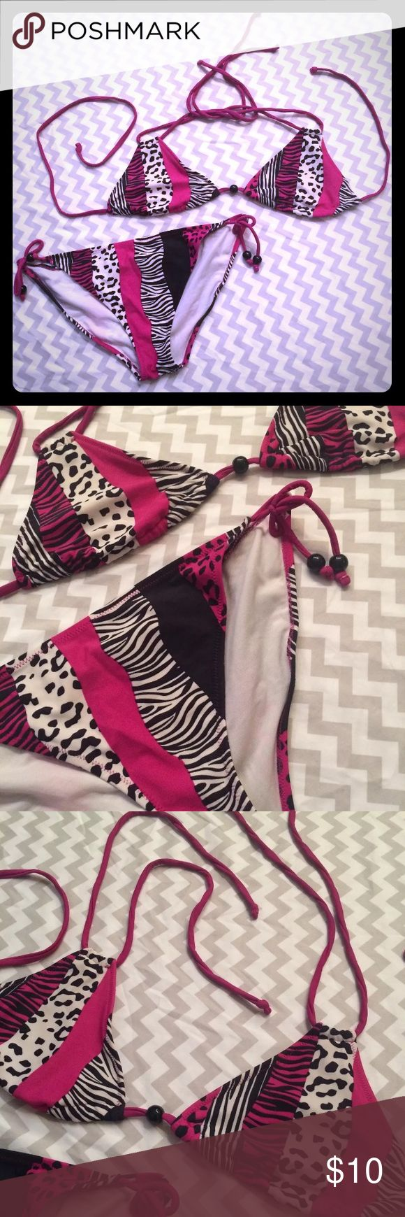 🏝Sold⛱Animal Print Two Piece Bikini Ladies two piece bikini bathing suit, hot pink, black, white animal print designs with beads. The top and bottoms are both attached by ties making them slightly adjustable. The tags are no longer attached to tell size or brand but I believe it is a size large in women's. In gently used condition with no stains or rips. Unbranded Swim Bikinis