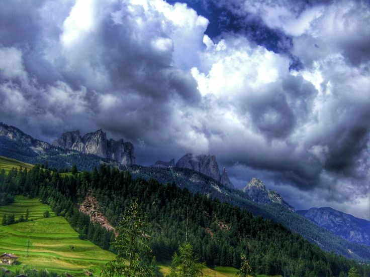 mountain, sky, cloud - sky, tranquil scene, tranquility, scenics, cloudy, landscape, mountain range, beauty in nature, nature, weather, cloud, non-urban scene, grass, overcast, idyllic, tree, remote, day