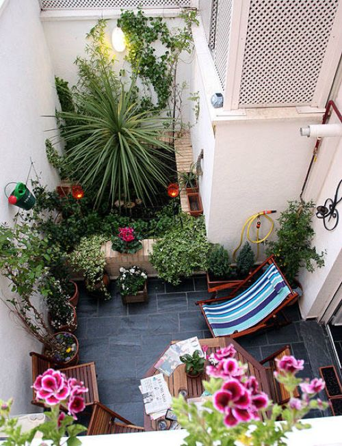 Small patio: 1) Hang planters and use then on the floor as well. 2) Mix beach lounger with other wood furniture. very simple and beautiful.