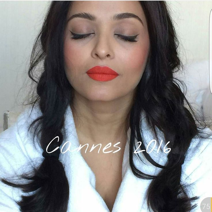 Aishwarya Rai Bachchan in prep this morning #cannes2016 #orangelips…