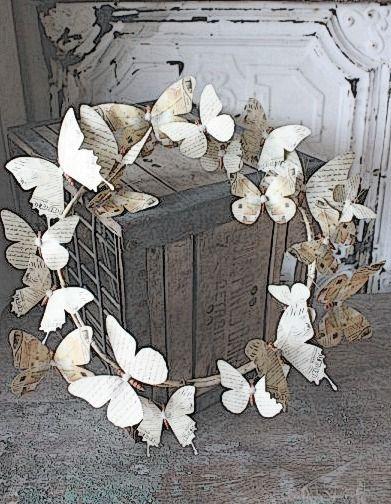Mooie krans met vlinders, makkelijk zelf te maken lijkt me.