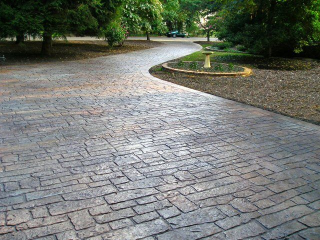 Cobblestone stamped concrete backyard pinterest for New concrete driveway
