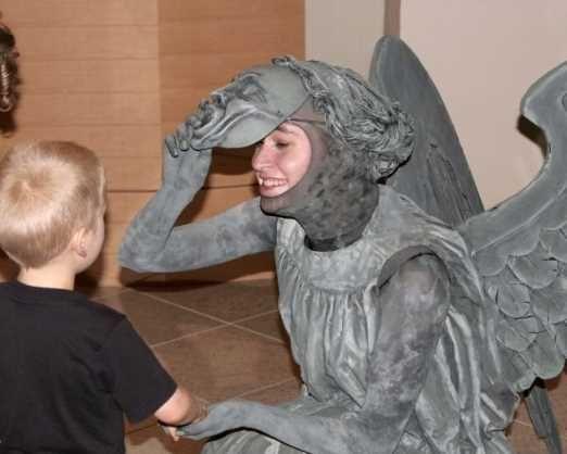 """Amazing """"Weeping Angel"""" Doctor Who cosplay costume! (I had to pin this photo because it was the one where you could tell it was a costume.  She actually looks like statue in the other photos!) #DoctorWho"""