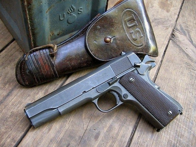 This is the 1911-A1 Colt .45 which was standard issue to U. S. military troops 1920s thru 1970s until the Beretta M-9 became the standard issue.  This differs from the 1911 which had the straight grip housing and minor parts that were improved upon in the 1911-A1.