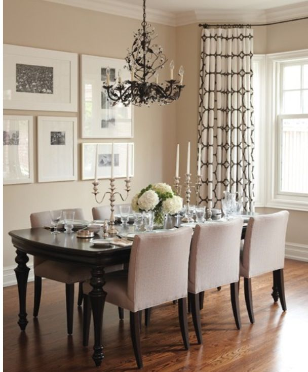 Floor-length curtains with rod mounted just below crown molding to add height