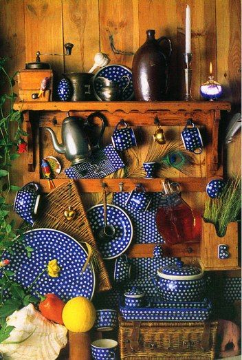 "Old Pottery - Unique to traditional Polish Pottery patterns are the ""eye spot"" designs inspired by the peacock feather.Polish Pottery is distinguished by its clean lines and captivating designs in cobalt blue, forest green and the earth tones."
