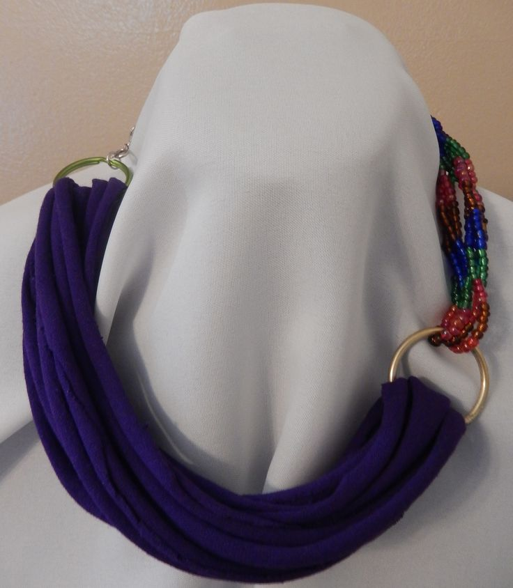 Purple half rope style, half beaded necklace with ring worn another way.