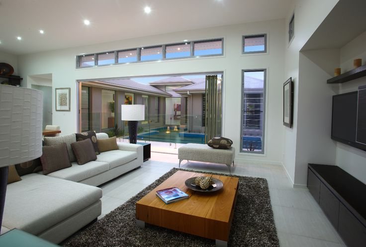 Entertainment. Media. TV Room. Glass features. Pool. Open living. Lighting. G.J. Gardner Homes. Australia.