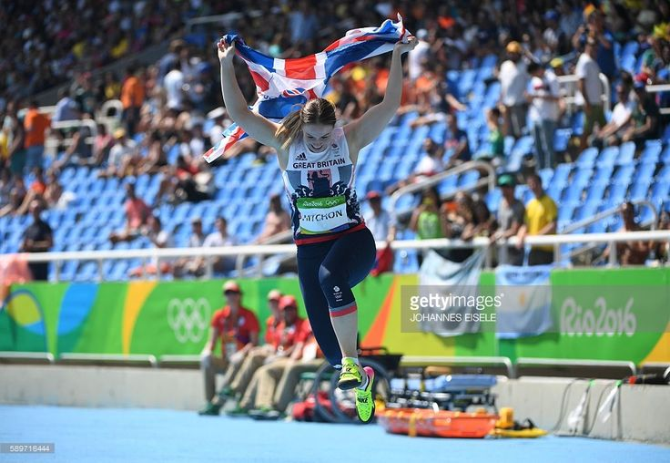 Great Britain's Sophie Hitchon celebrates her third place in the Women's Hammer Throw Final during the athletics event at the Rio 2016 Olympic Games at the Olympic Stadium in Rio de Janeiro on August 15, 2016. / AFP / Johannes EISELE