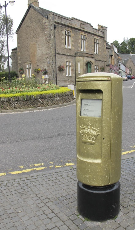 Post box, painted gold, in Dunblane. This was painted in honour of Andy Murray's achievements at the 2012 Olympic games, winning a gold medal for tennis.