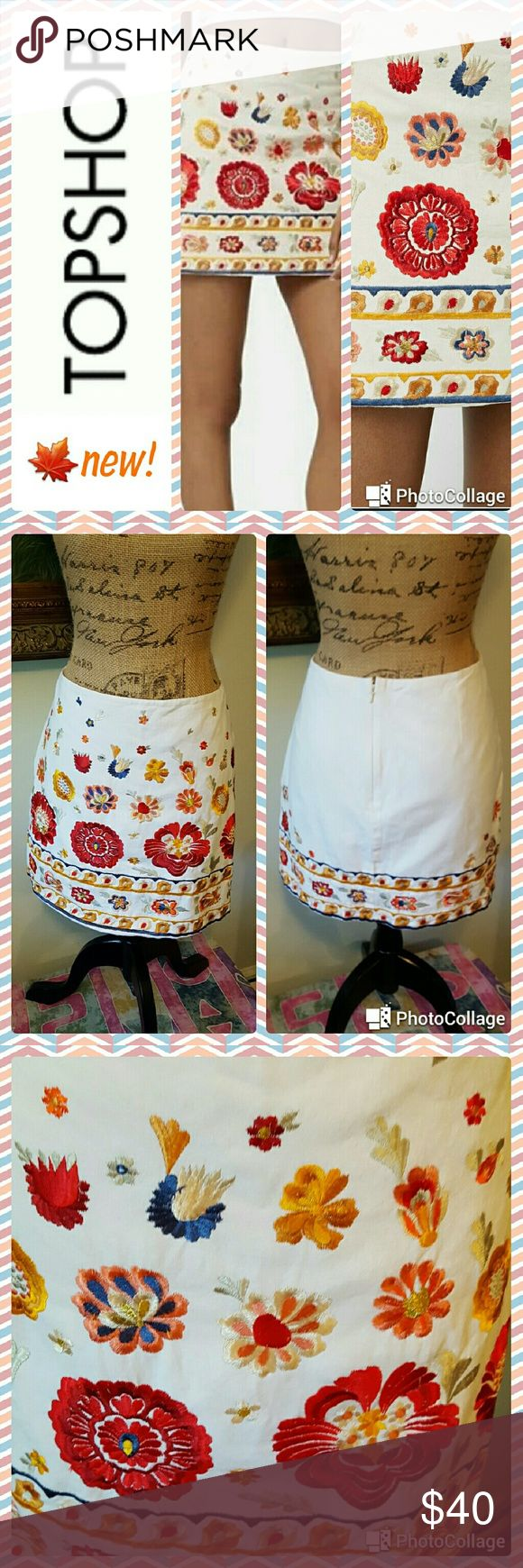 """Topshop Embroidered Align Mini Skirt In excellent condition. Topshop skirt. Ivory cotton align mini skirt with beautiful embroidered detail on front and back near hem. Back zipper. Drop waist. Measurements are length 16.5"""", waist 35"""". Topshop Skirts Mini"""