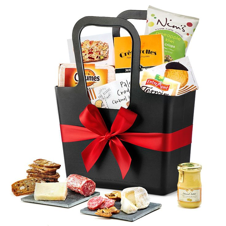 A delicious assortment of French cheeses, Italian salami, crispy crackers, and tasty butter cookies are tucked into a versatile Koziol tote bag.