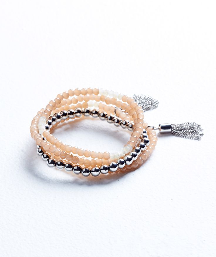 Channel the boho trend in this stretch bracelet set featuring delicate silver tassels with a 3/4 sleeve printed tunic.