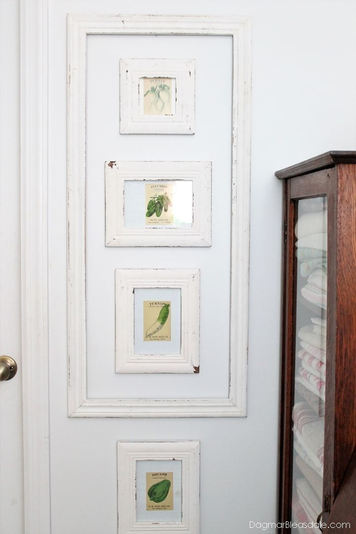Easy seed packets wall decor in our Blue Cottage. DIY unique wall decor. #DIY #crafts #homedecor #vintage #seed #packets #wall #frames #shabbychic
