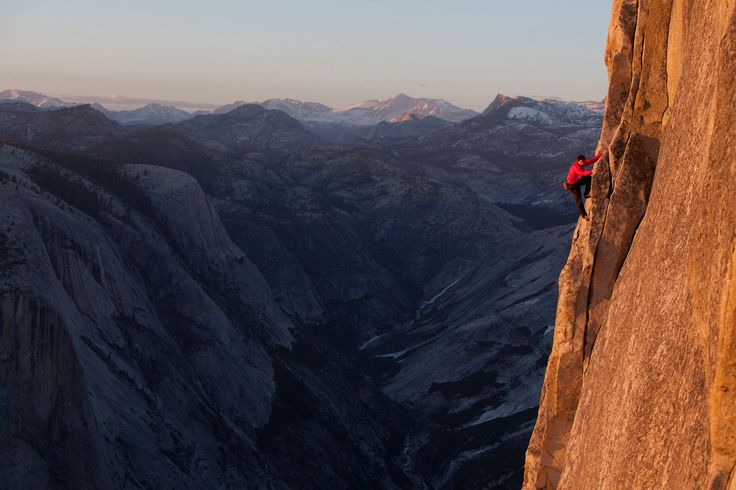 Picture of Alex Honnold reenactting his rope-less free climb of the 2,500 ft. NW face of Halfdome