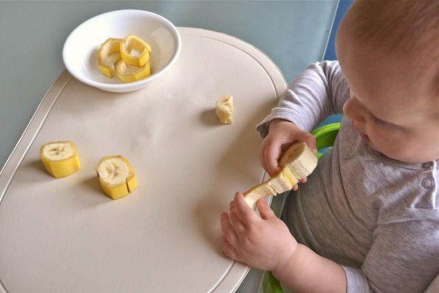 1 year old preparing his own snack