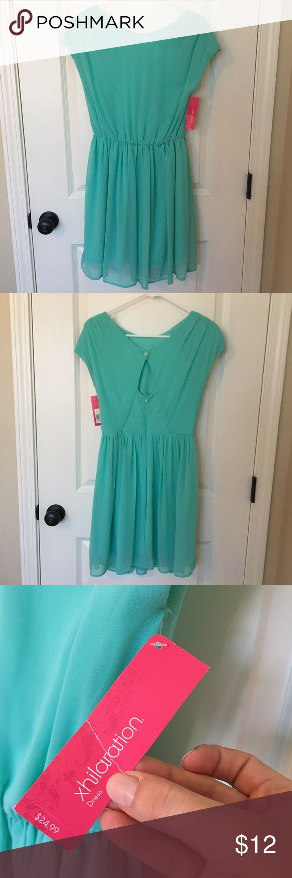Mint green high neck dress. NWT Short mint green dress made of a silky sheer material but fully lined. Has a small keyhole on the back with a button. Never worn. Xhilaration Dresses