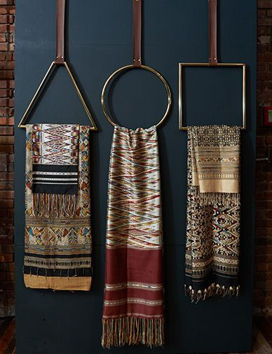 Bold display to showcase scarves against a dark moody background.