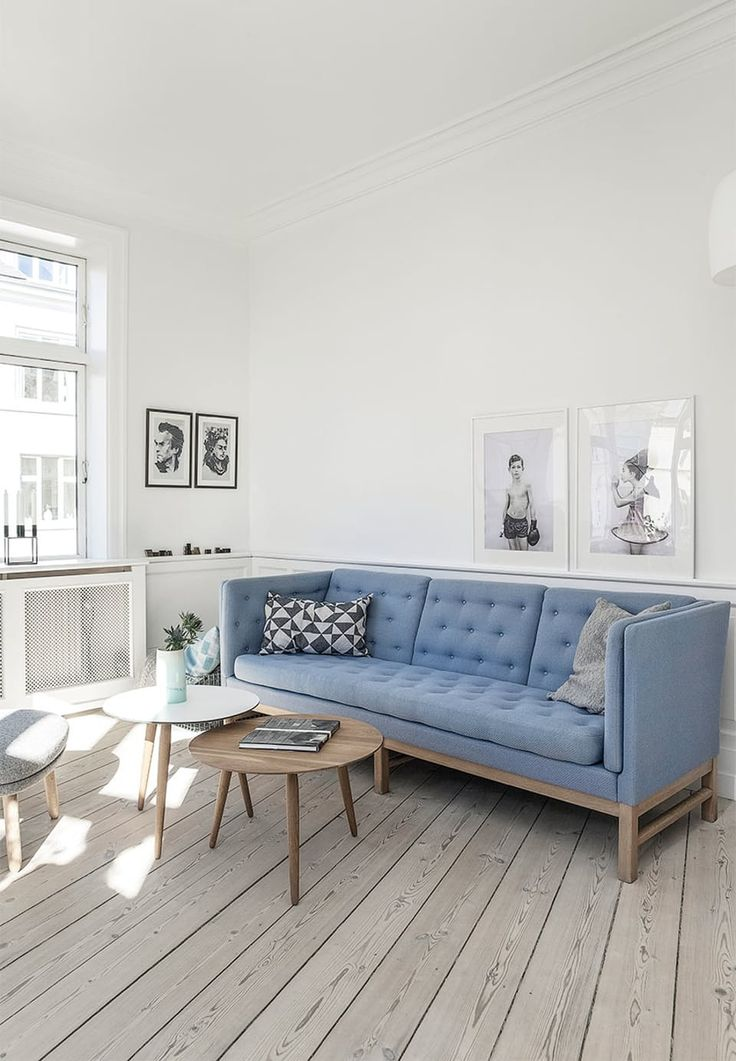 Stylish living room with a flexible look. Sofa from Erik Jorgensen and coffee tables from Bruun Munch. All able to be moved around.