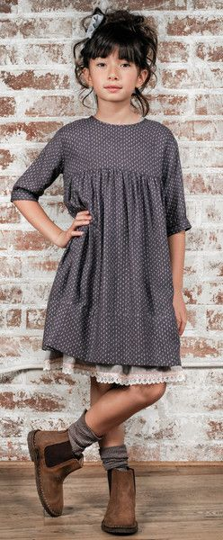 This site has some cute style....I wonder if my girls would agree.  I like the tiered slip/skirt with the tunic over it.