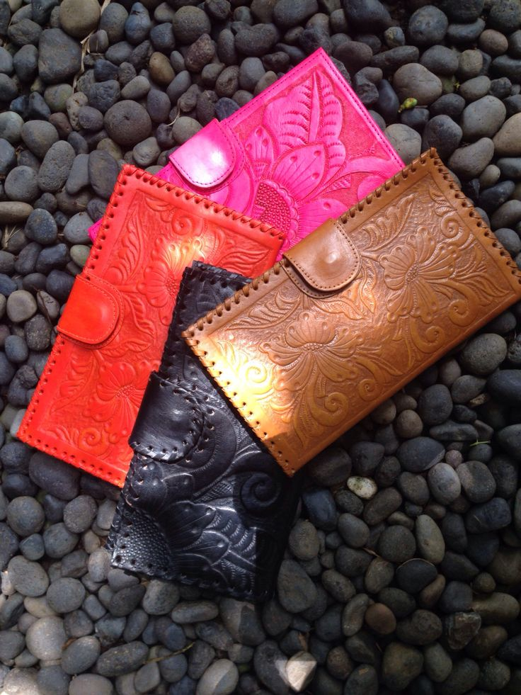 Hand tooled leather clutches
