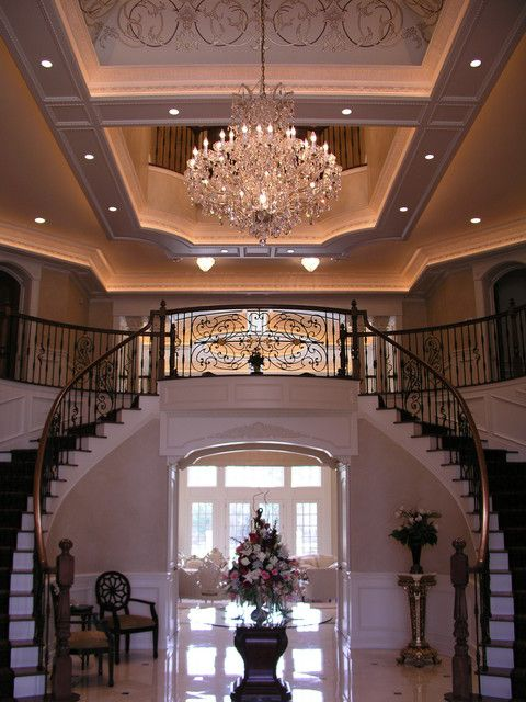 Love this grand foyer traditional staircase for the for House plans with stairs in foyer