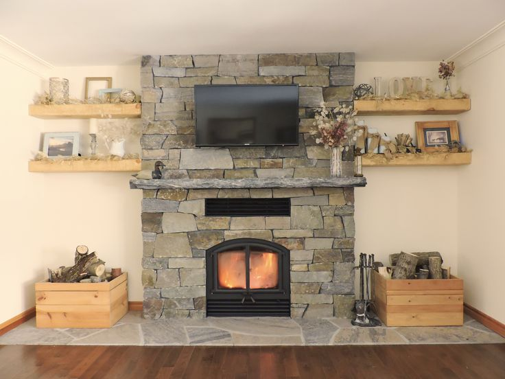 Home sweet home. Wood burning fireplace - Opel 2 by RSF Stone is real Muskoka Granite from Ontario Stone Depot. Mason - Adam Saunders