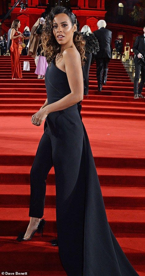cb8c64662b6 Work it  Rochelle Humes made a style statement in an off-the-shoulder black  jumpsuit with a dramatic train at the back