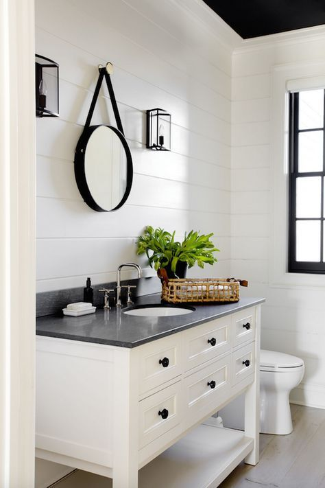 modern farmhouse bathroom, shiplap walls, white vanity, black counter and accessories