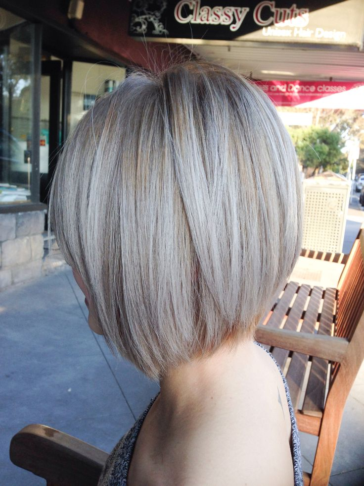Ash blonde highlights with concave bob .