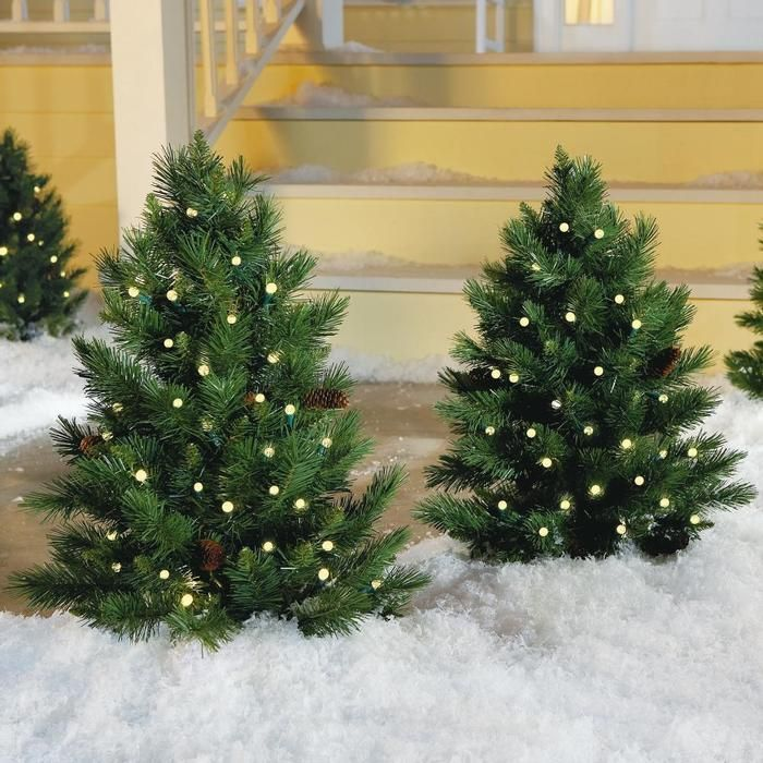 These prelit Christmas trees are ideal for lining outdoor walkways or framing the entryway to your home. Get in the holiday spirit. & 59 best Christmas at Brookstone images on Pinterest | Pine cones ...