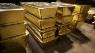 Gold powers miners to send the FTSE 100 to a new high