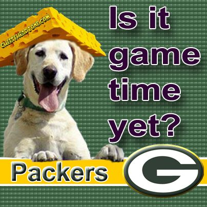 Cheesehead wearing dog want's to know if the Packers are on tv yet?
