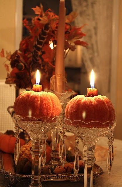 pumpkin candles, really cute idea for halloween clearance items and vintage candle holders to make an elegant thanksgiving tabletop