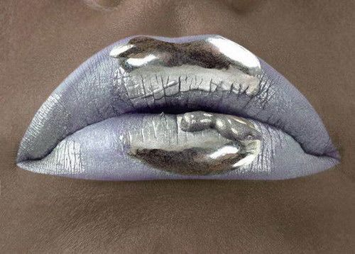 Poisonous kiss: silver makeup, with chromed lipstick to look like they were dipped in mercury.