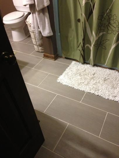 Tile from home depot.  $31.84 per case (16 soft) Metro charcoal 12in x 24in