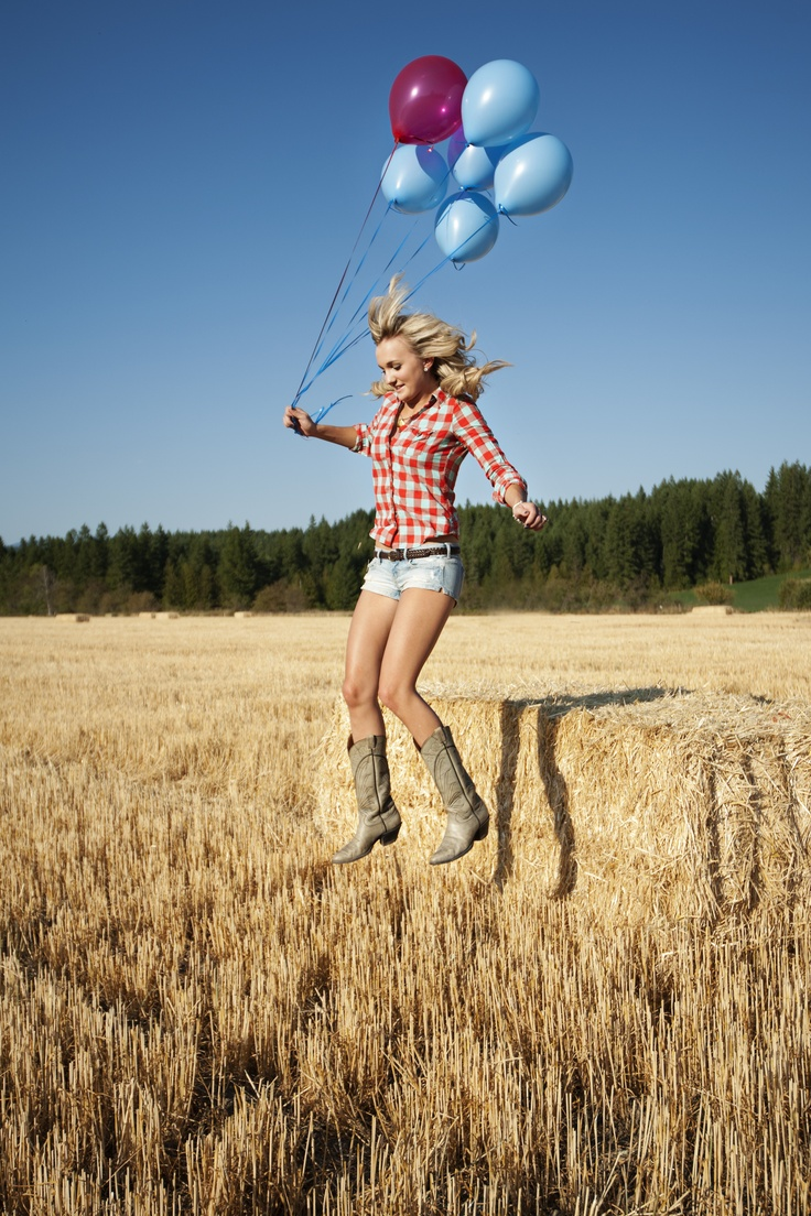 Dress for your location. If you're shooting in a field next to a haybale, a cute plaid shirt, cutoff shorts, and cowboy boots keep the look timeless and Country.