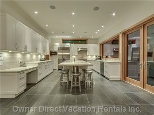Beautiful and sparkling silver gray and white themed modern kitchen. Complete with all that a Chef would need and has a large center island. Great for entertaining! #Whistler #BritishColumbia #OwnerDirect #vacation #travel #ski