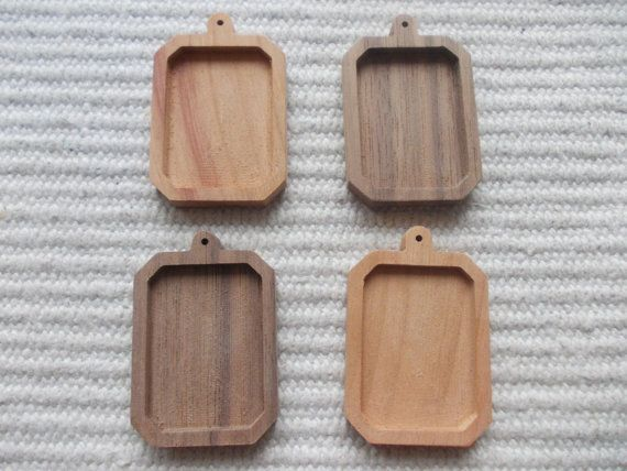 4pc unfinished rectangle shaped pendant base with round hook and slightly cut corner,rectangle blank pendant setting/base bezel cup  4 pieces dark walnut/cherry wooden rectangle shaped pendant/brooch base for jewel making. In the centre of the pendant there is a rectangle-shaped cabochon frame/hole, which gives a more attractive look to the pendant.   www.artwoodenstuff.com