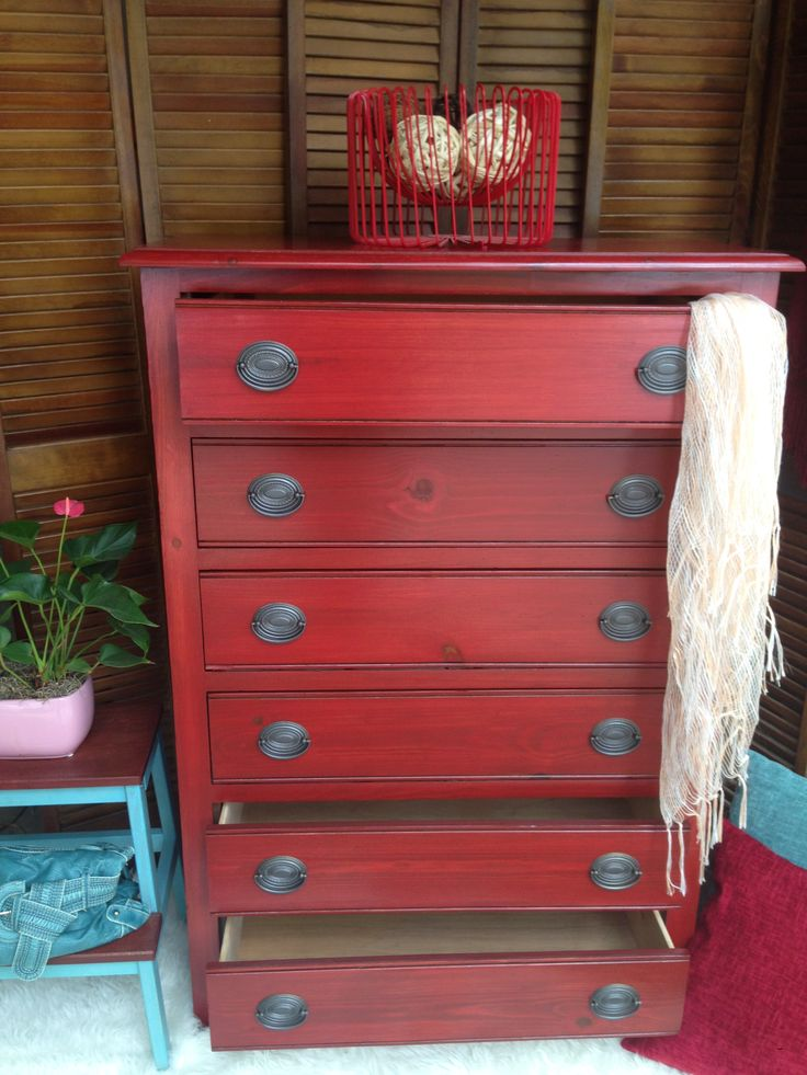 Restained in Barn Red, original pulls were spray painted. Top coated with  teak  oil and polyurethane